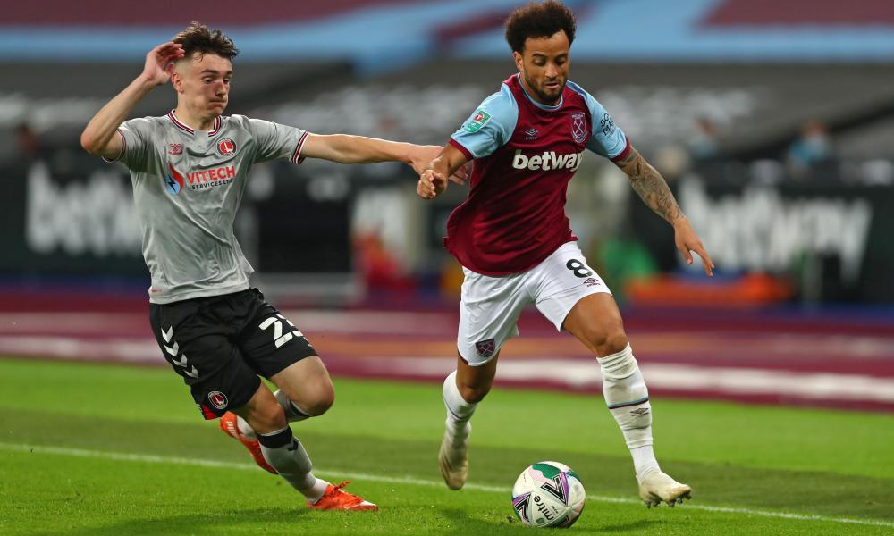 Charlton's Welsh midfielder Dylan Levitt (left) is left trailing behind West Ham's Felipe Anderson.