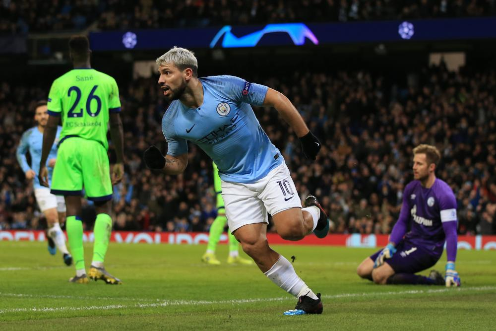 Sergio Aguero celebrates after scoreing his, and Manchester City's, second goal .