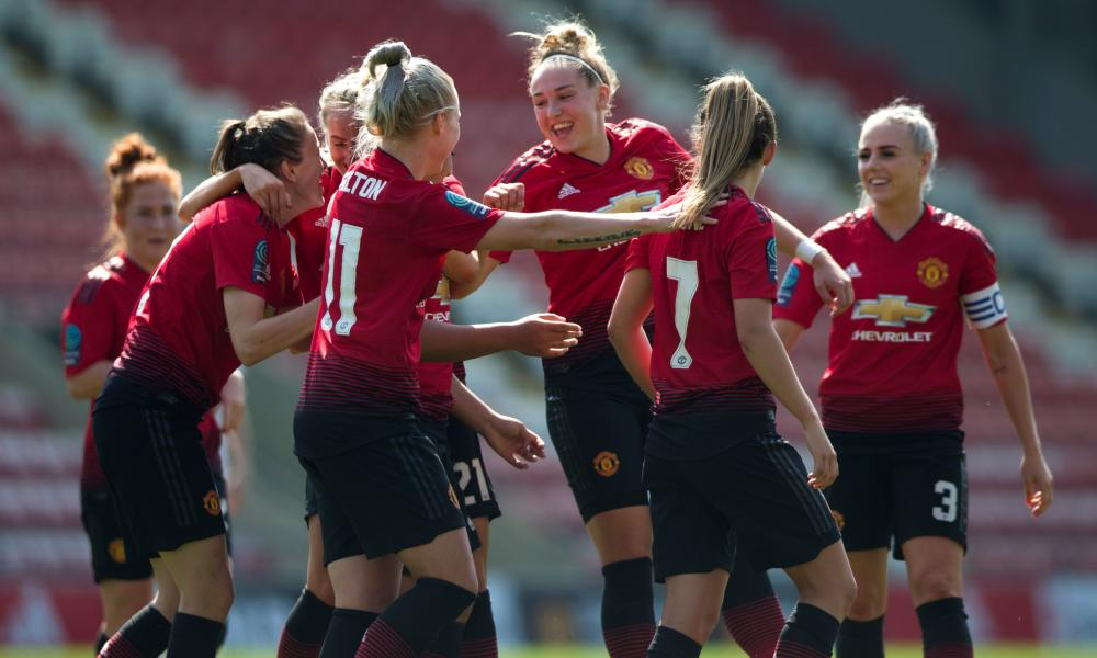 Manchester United celebrate their opener in a 7-0 rout of Crystal Palace on Saturday.