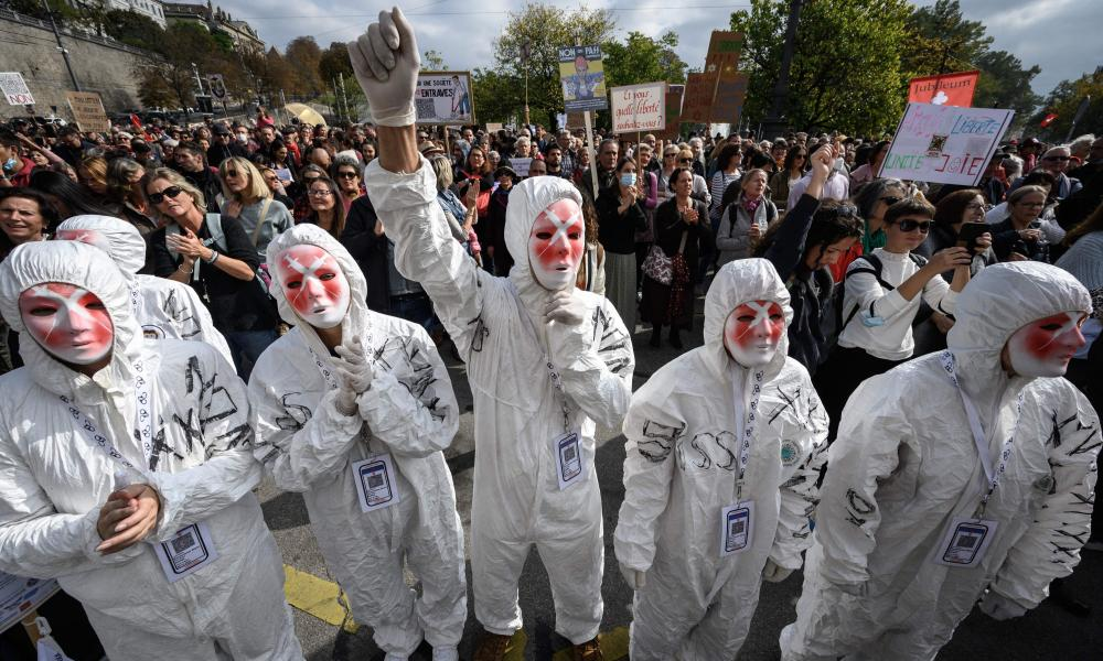 Protesters wear masks during a rally against coronavirus measures, Covid-19 health pass and vaccinations in Geneva, Switzerland.
