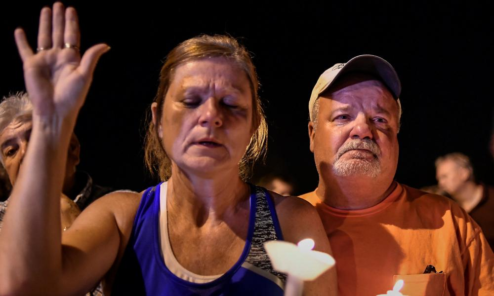 Local residents take part in the vigil.