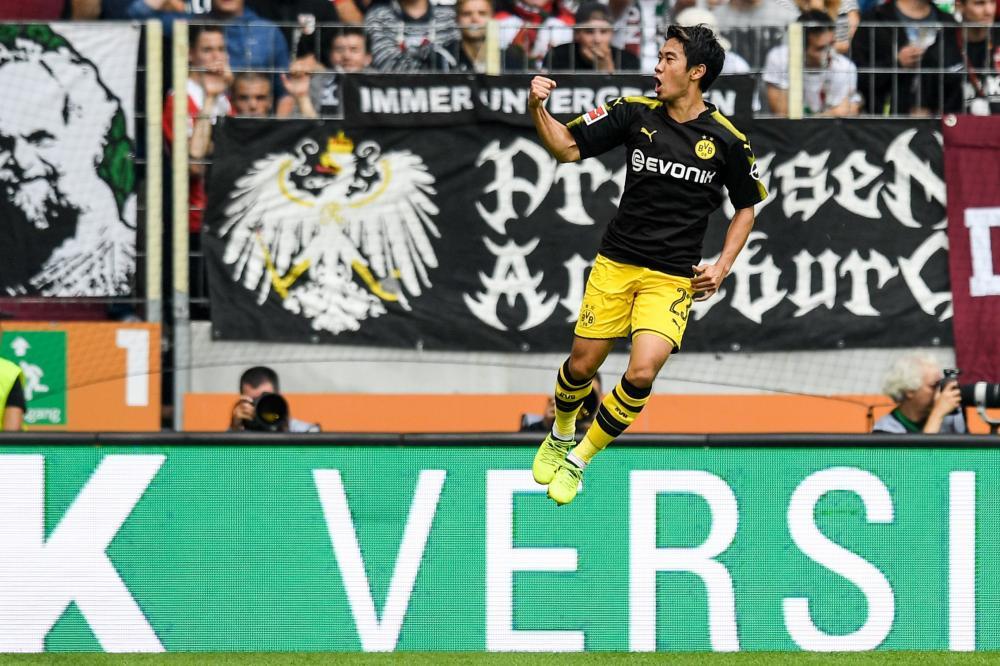 Kagawa celebrates after going past Shinji Okazaki as the highest-scoring Japanese player in Bundesliga history.