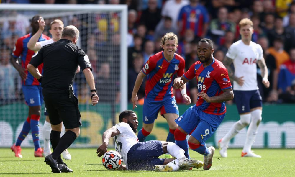 Jordan Ayew of Crystal Palace is felled by Japhet Tanganga which gets the Spurs player a second yellow and an early bath.