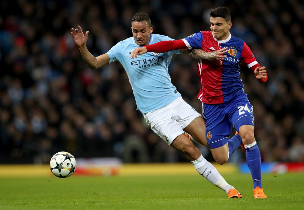 Danilo of Manchester City tussles with Basel's Mohamed Elyounoussi.