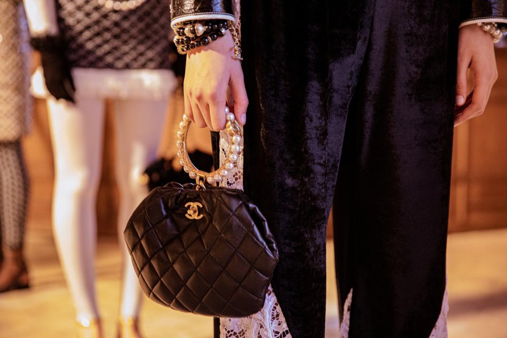 A model with one of Chanel's handbags