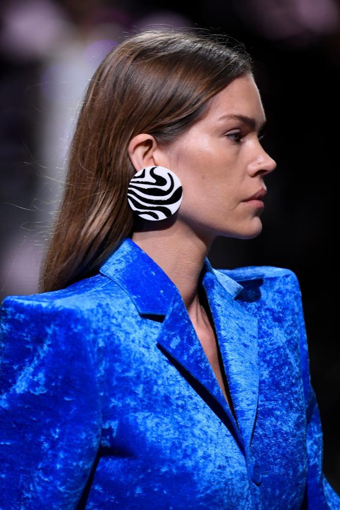 Model wearing blue wide-shouldered jacket