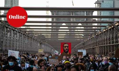 Demonstrators march across the Brooklyn Bridge as they remember George Floyd on the one-year anniversary of his death.