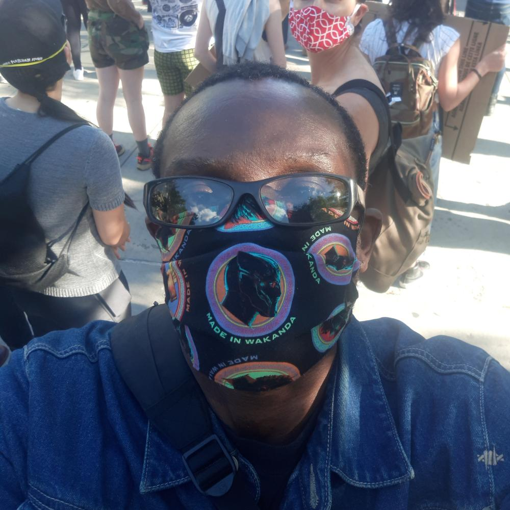 Cav wearing a 'made in Wakanda' mask at a protest in Brooklyn on Monday 1 June.