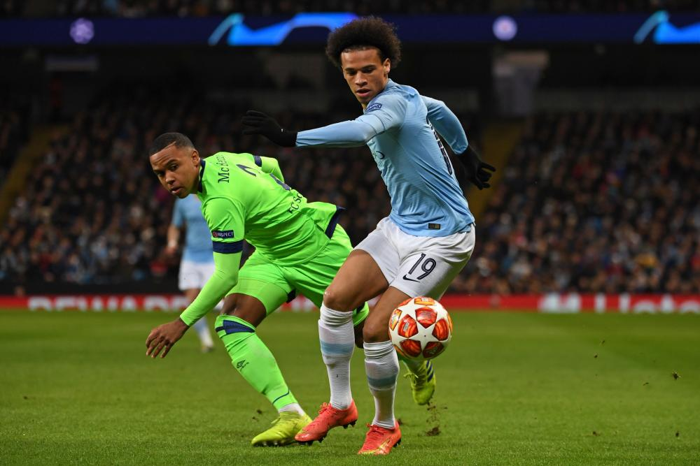 Manchester City's Leroy Sane goes past Schalke's Weston McKennie.