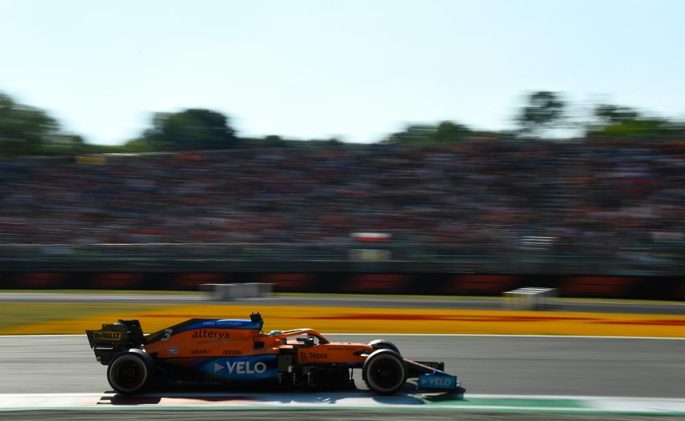 Daniel Ricciardo driving for McLaren.