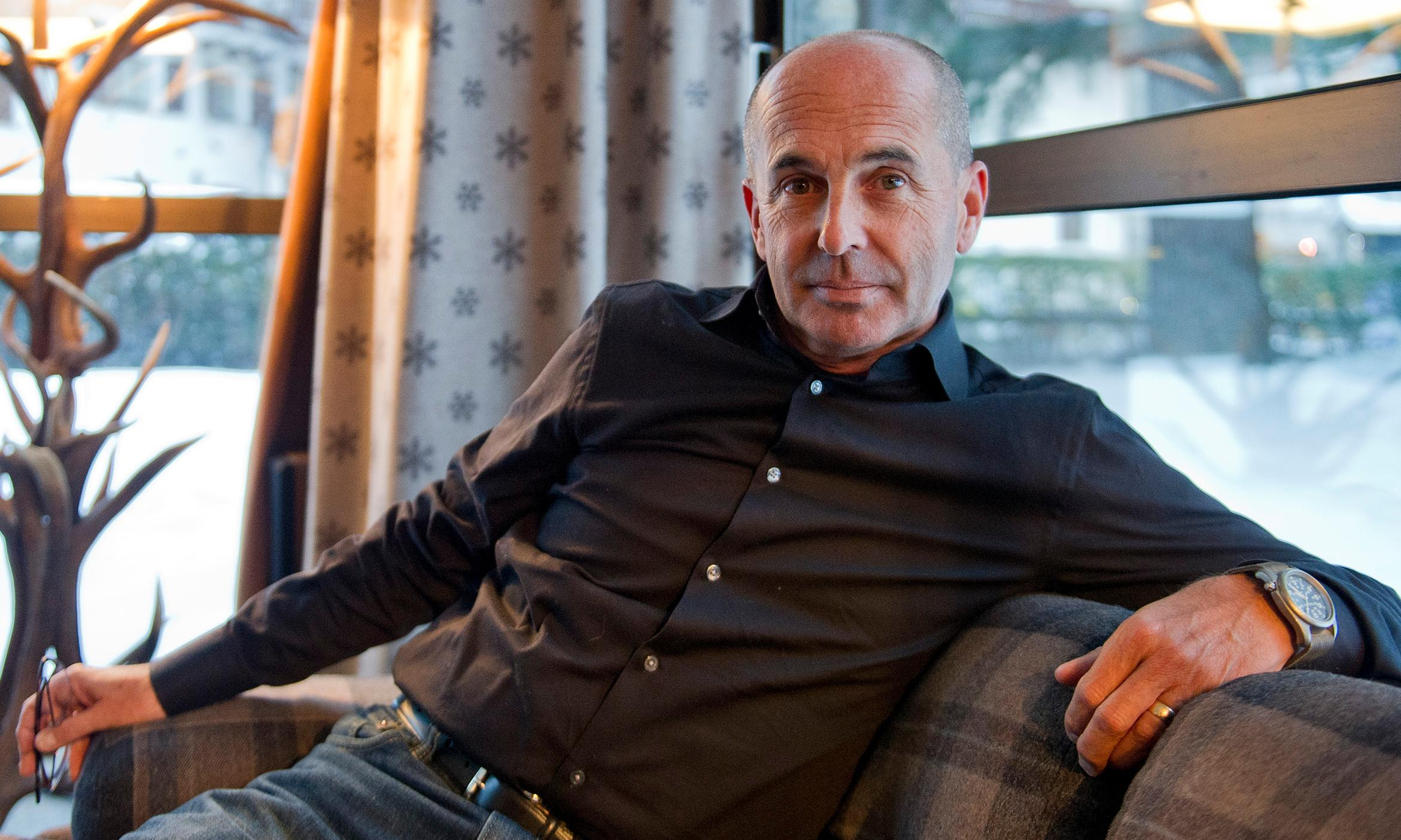 Crime writer Don Winslow challenges Trump to border wall debate