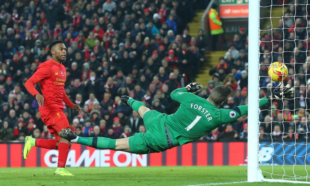 Southampton's Fraser Forster claws the ball off the goal-line and out of the reach of Daniel Sturridge to deny Liverpool an equaliser.