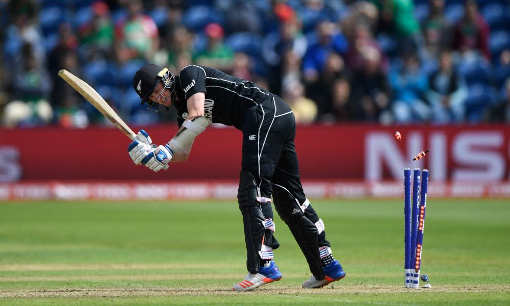 New Zealand batsman Adam Milne is bowled by Mustafizur Rahman.