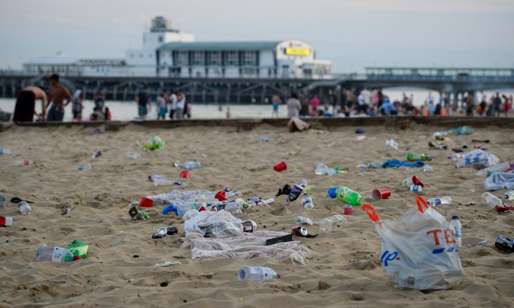Rubbish litters Bournemouth beach after visitors leave on Thursday.