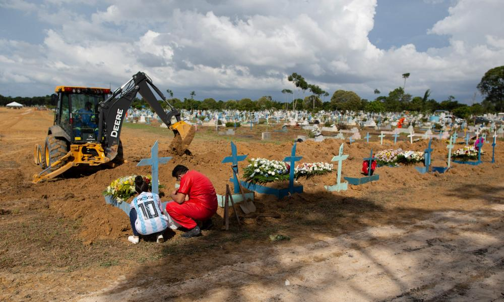 A burial takes place in a new area of the Nossa Senhora Aparecida cemetery reserved for Covid-19 victims, in Manaus, Brazil.