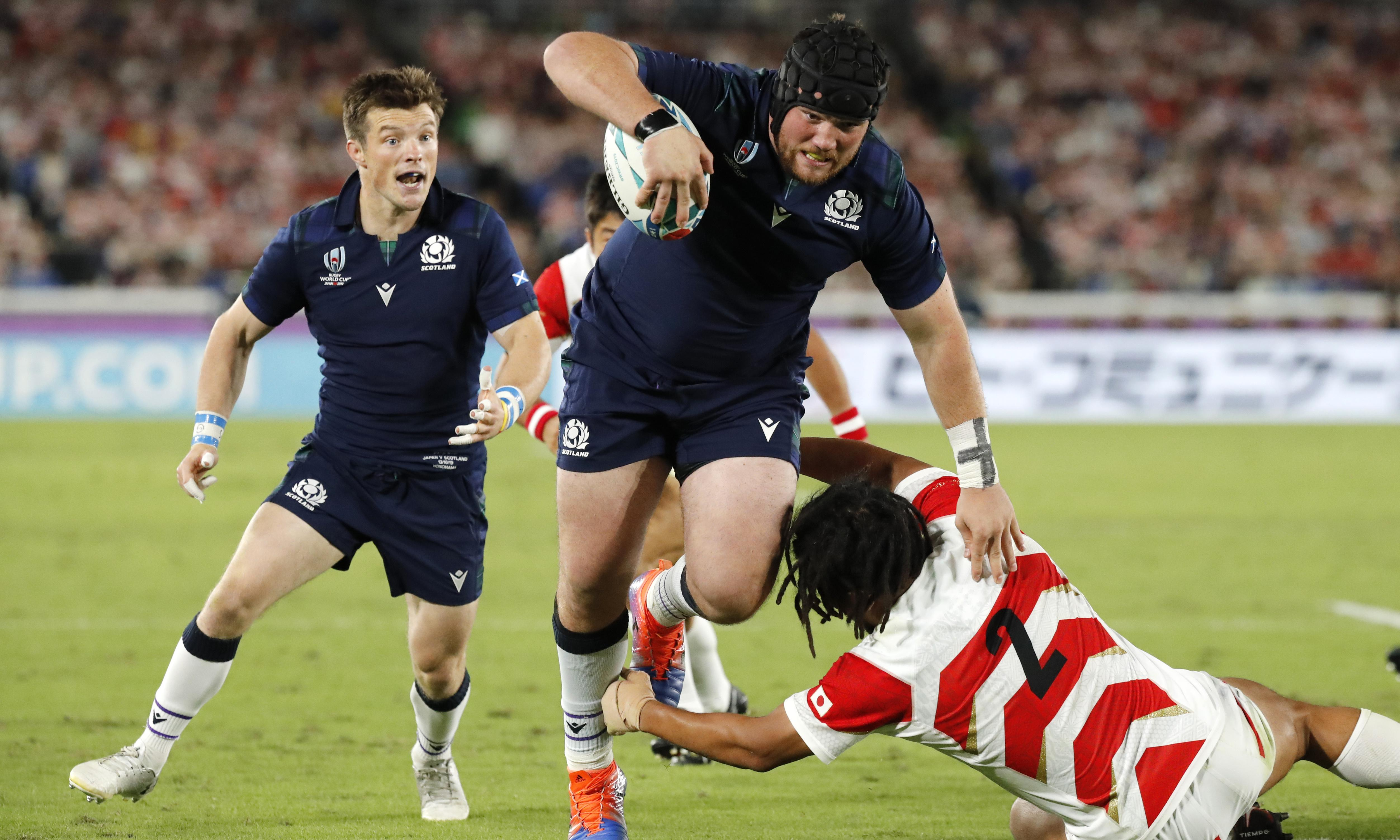 Japan hang on to reach Rugby World Cup last eight and send Scotland out