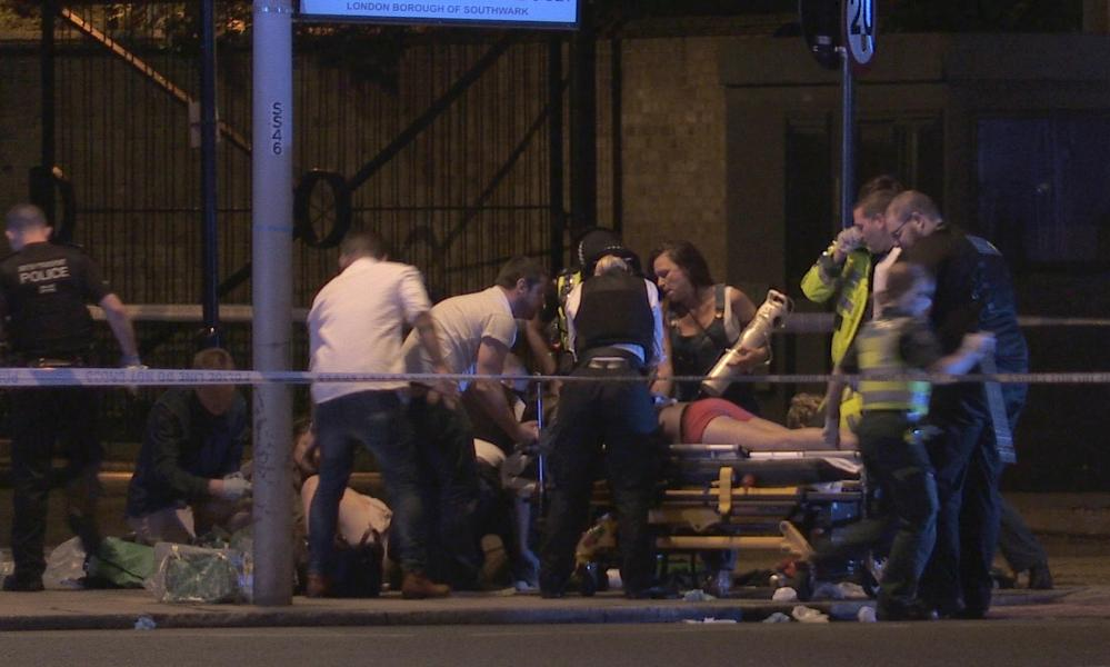 Screen grab from a PA video of people receiving medical attention in Thrale Street near London Bridge.