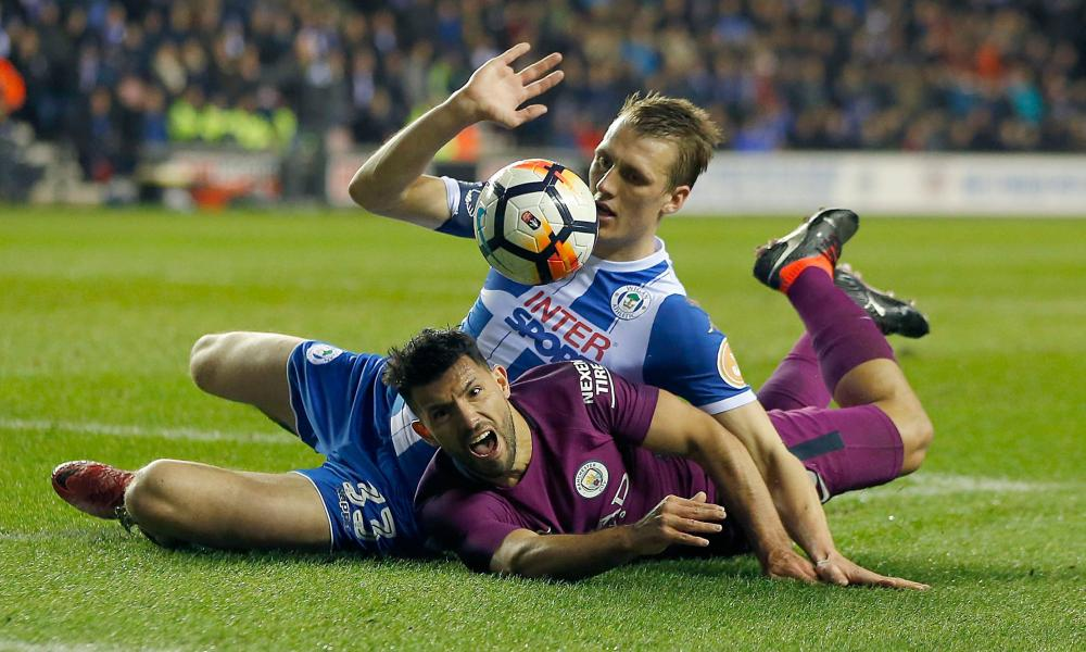 Sergio Aguero is tackled by Dan Burn.