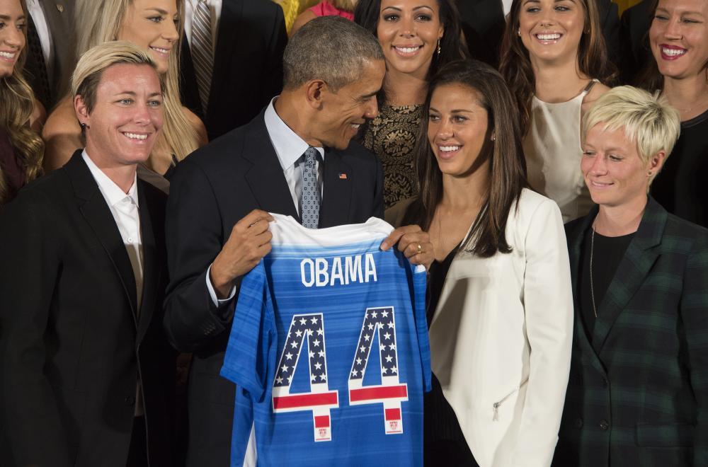 Megan Rapinoe and Barack Obama