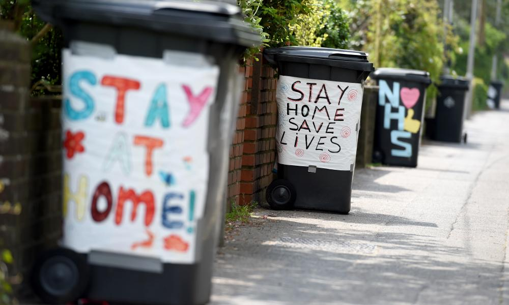 Rubbish bins decorated with coronavirus-related slogans in Poole today.