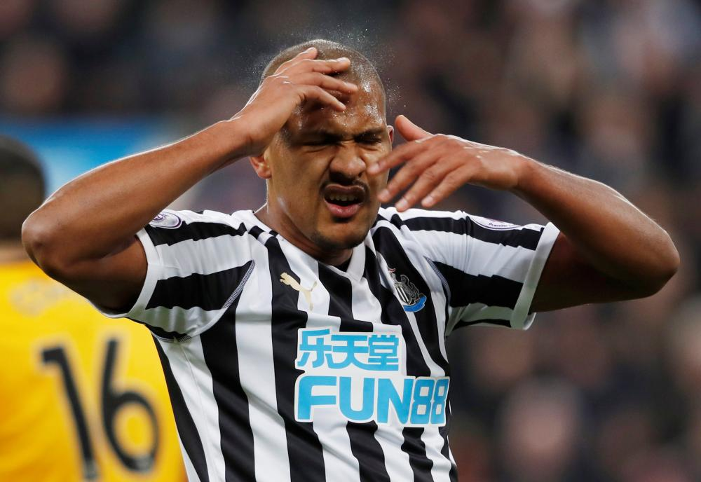 December 9: Newcastle United's Salomon Rondon wipes his face against Wolves.