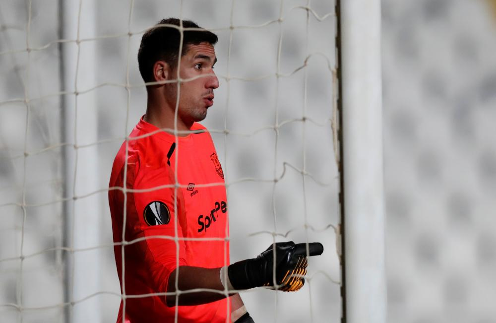 Everton keeper Joel Robles lines up his wall.