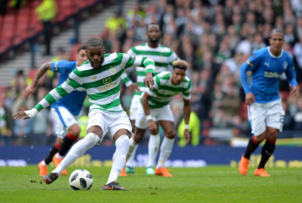 Ntcham scores Celtic's fourth from the spot.