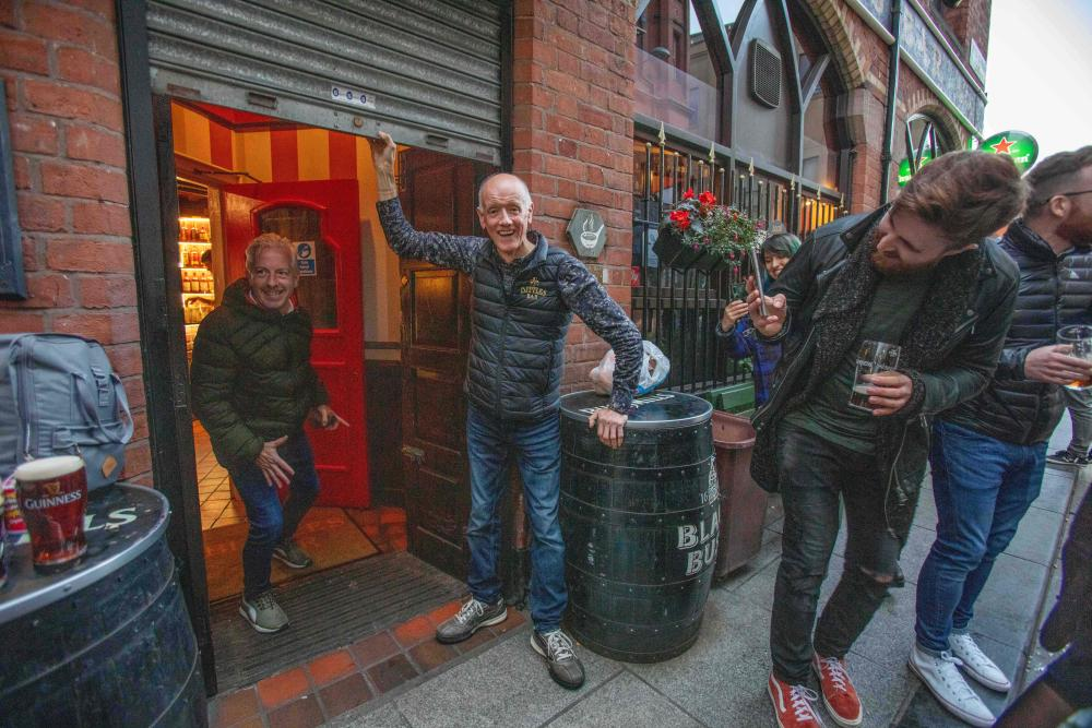 Bittles bar owner John Bittles closes his pub in Belfast on 16 October, 2020, as Northern Ireland imposes tighter coronavirus restrictions on the hospitality sector amid an uptick in Covid-19 cases.