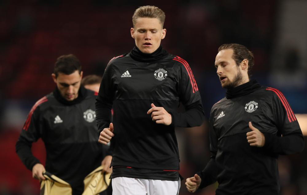 Scott McTominay warms up before the match against Benfica.