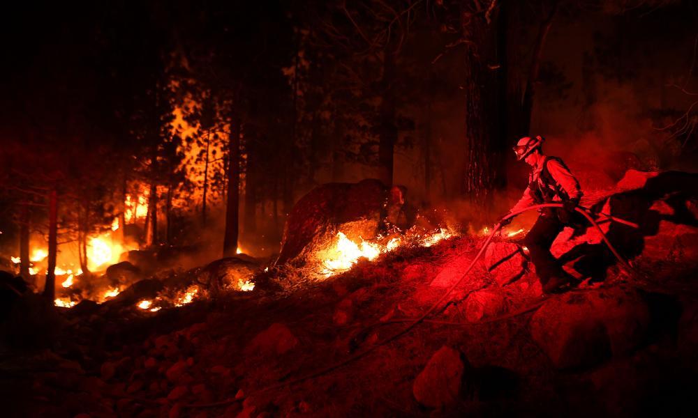 Firefighters battle the Caldor fire near Lake Tahoe on 5 September.