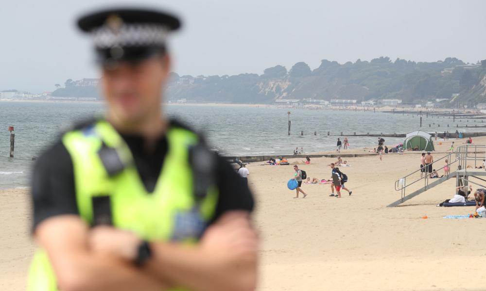 Police patrol near Bournemouth pier on Friday, as thunderstorms and torrential rain are forecast to sweep across the UK.