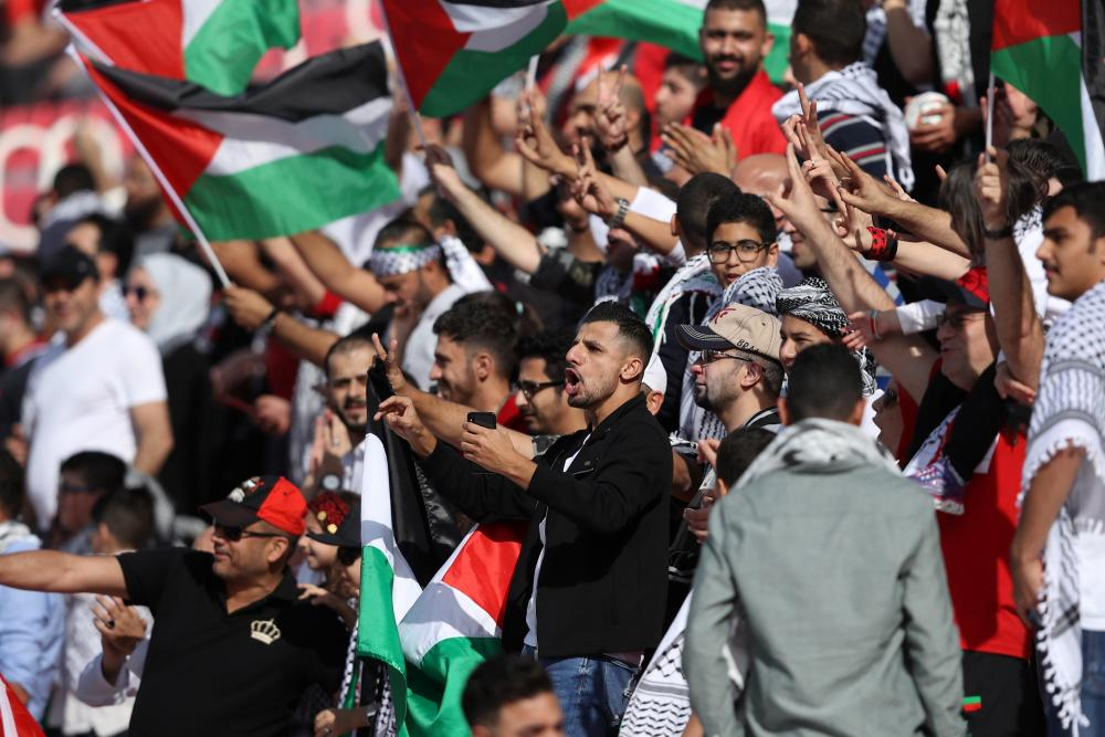 Palestine supporters in full voice at the Rashid Stadium.