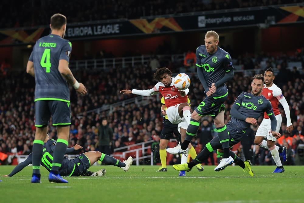 Iwobi tries his luck from distance.