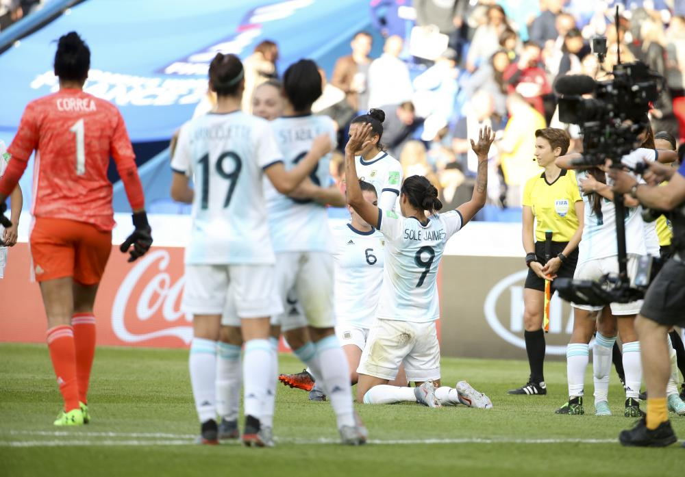 Argentina players celebrate after the final whistle of the 0-0 draw against Japan at Parc des Princes.