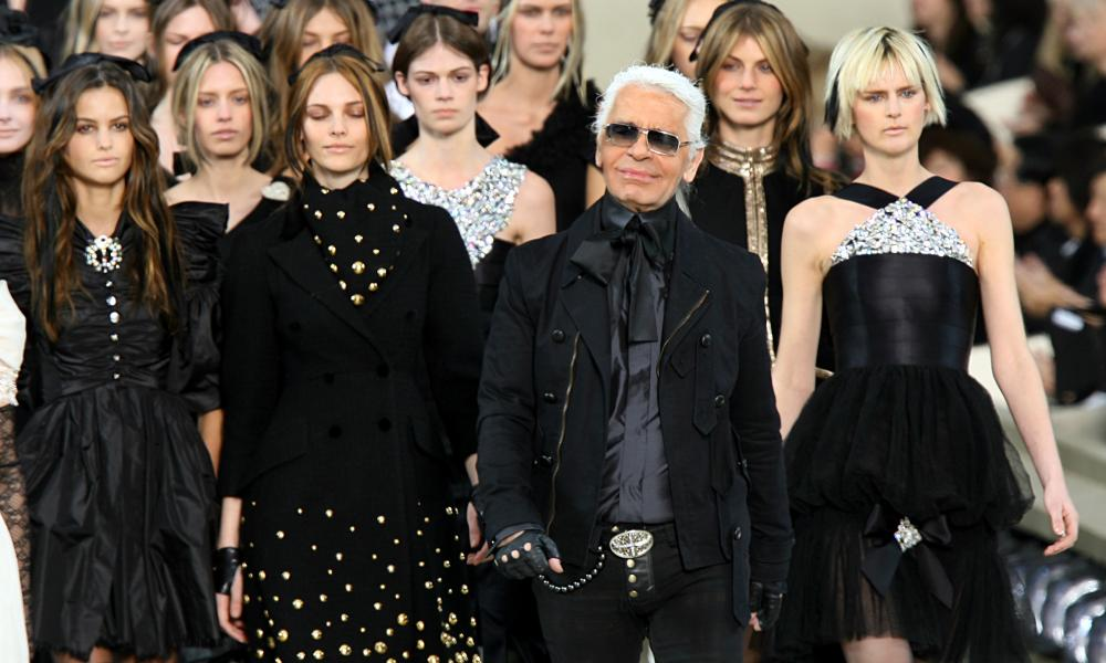 Karl Lagerfeld leading models on the catwalk at the end of the autumn/winter ready-to-wear Chanel collection in Paris.