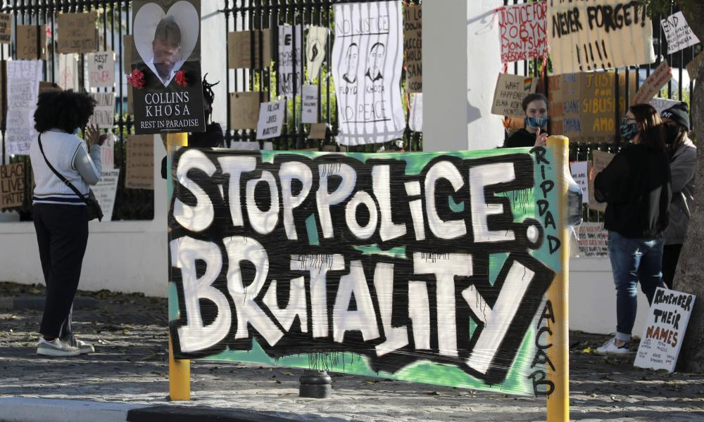 A protest outside parliament in Cape Town about the killing of George Floyd in the United States and Collins Khosa, (pictured on poster), in Alexandra township near Johannesburg. Khosa's family said he was beaten to death by law enforcement officers over a cup of beer left in his yard during the coronavirus lockdown.