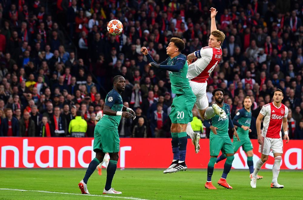 De Ligt scores the opener for Ajax.