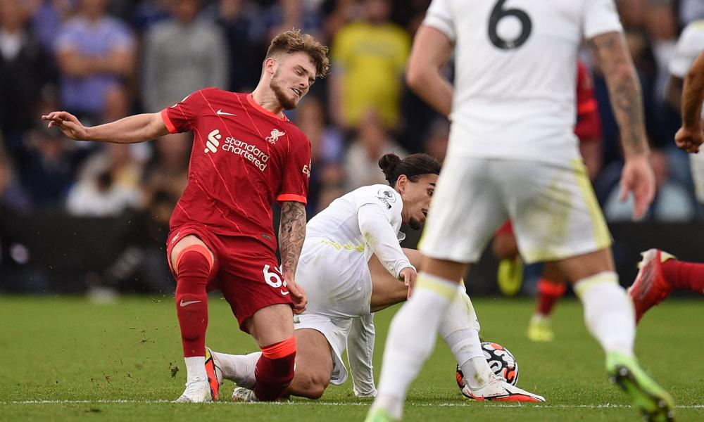 Liverpool's Harvey Elliott suffers a fractured ankle in a tackle by Leeds' Pascal Struijk, who was sent off.
