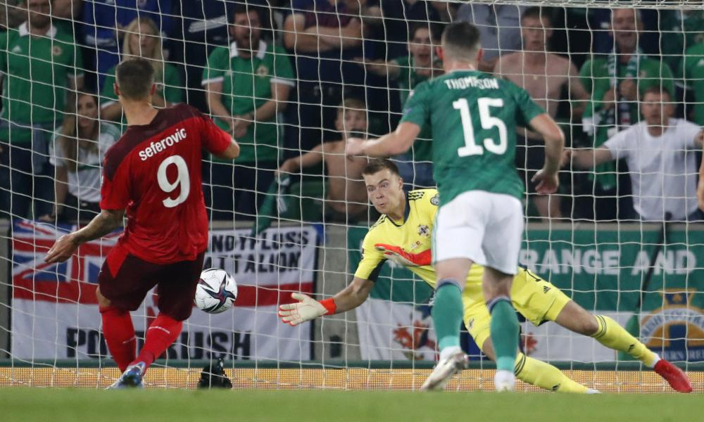 Northern Ireland's goalkeeper Bailey Peacock-Farrell saves Haris Seferovic's penalty