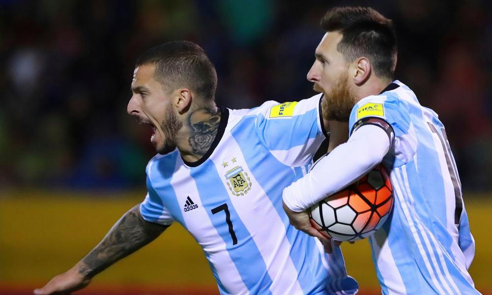 Lionel Messi and Dario Benedetto race back to restart the game after Messi's equaliser.