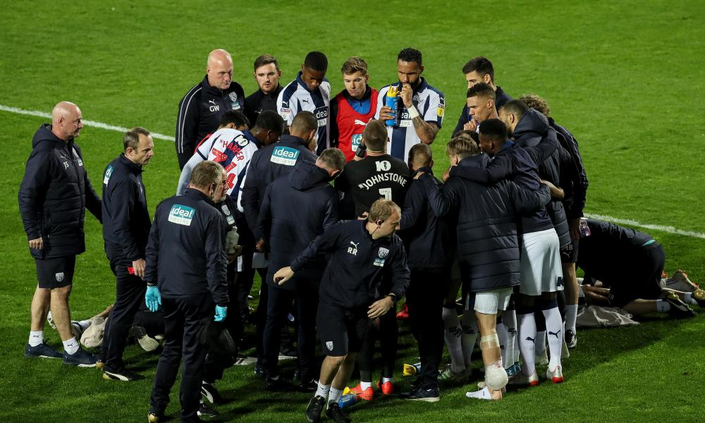Baggies players and staff have a team talk from manager Jimmy Shan.