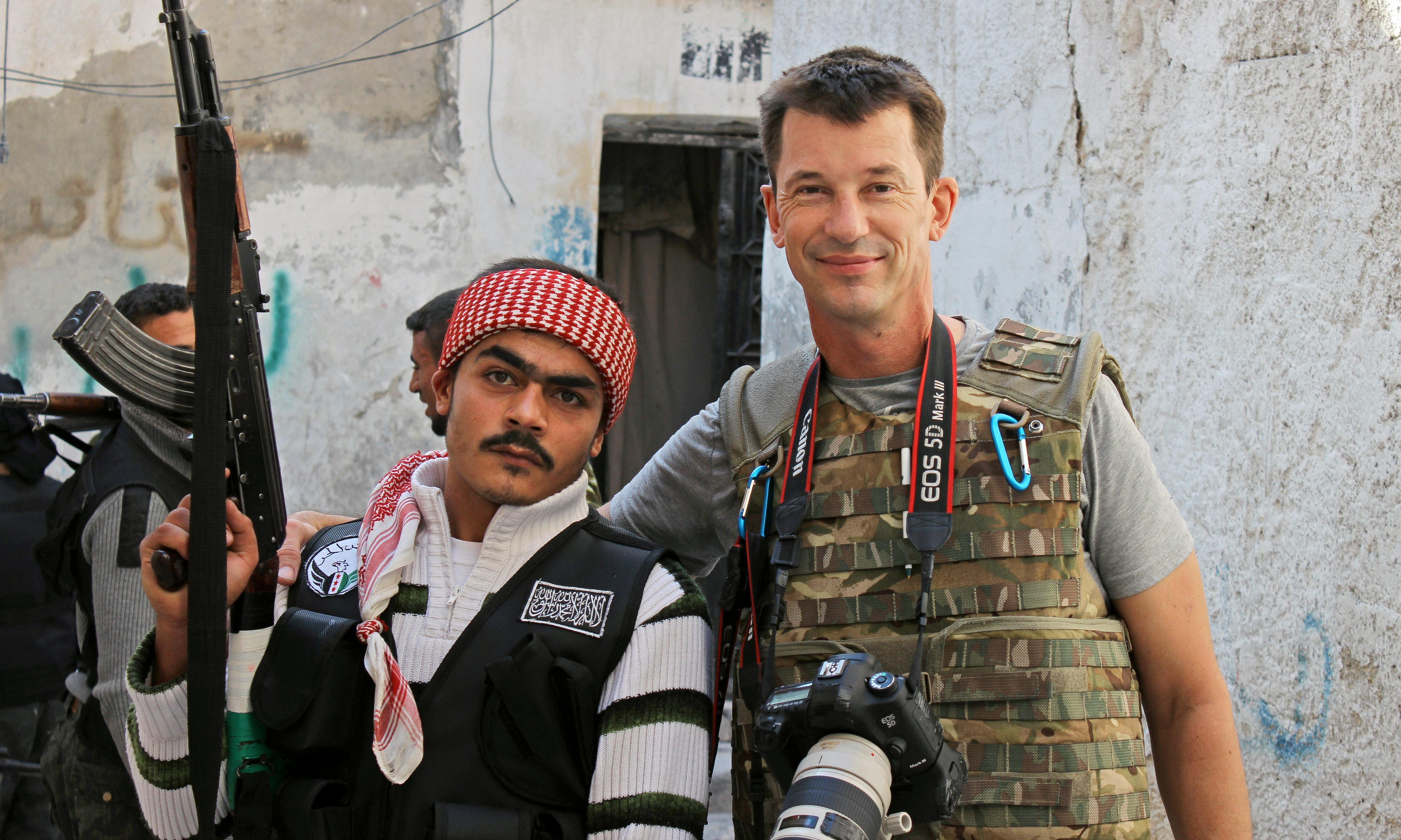 British Isis hostage John Cantlie still alive, UK government says