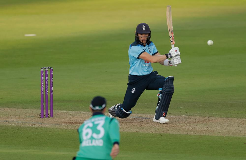 England's Sam Billings hits another boundary.