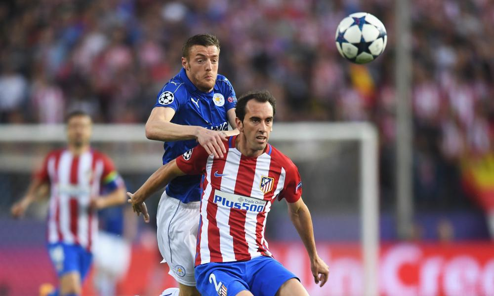 Jamie Vardy of Leicester City challenges Diego Godín during Atletico Madrid's 1-0 victory in the Champions League quarter-final first leg in Madrid.