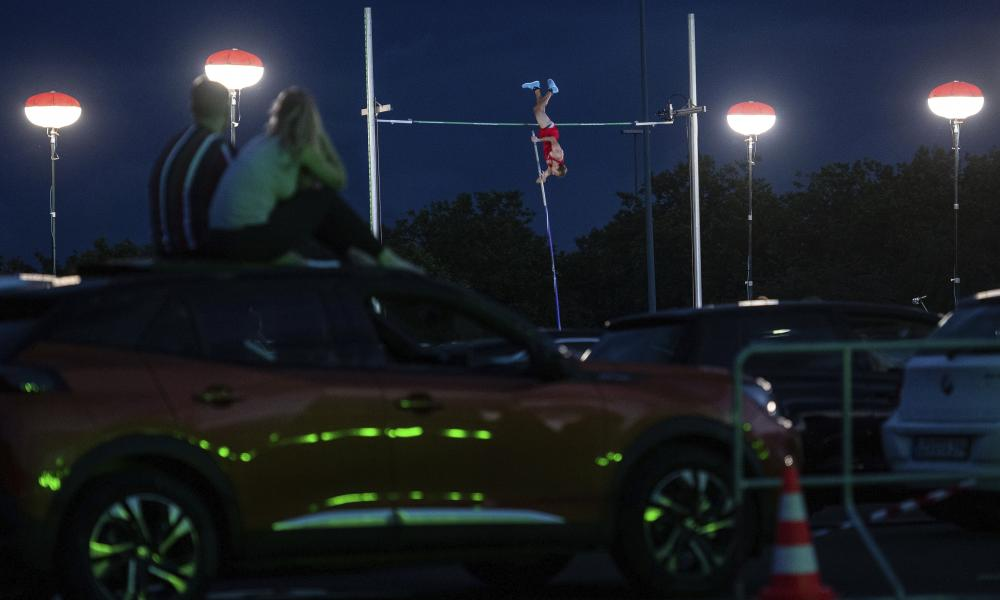 """The German pole vaulter Karsten Dilla jumps at the """"psd Flight Night"""" on Friday in Duesseldorf, Germany. Spectators can watch the competition from their cars."""