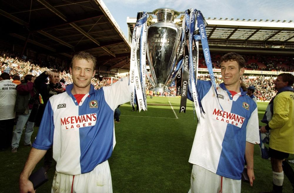 Alan Shearer and Chris Sutton celebrate with the Premier League trophy.