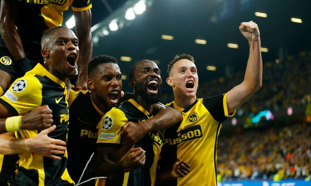 Young Boys' Moumi Ngamaleu celebrates scoring their first goal with teammates.