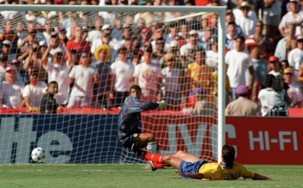 Colombia's Andrés Escobar scores an own goal at USA 94. He was murdered in Medellín not long after.