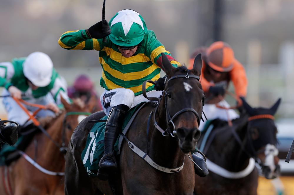 Barry Geraghty uses his whip to guide Saint Roi to victory