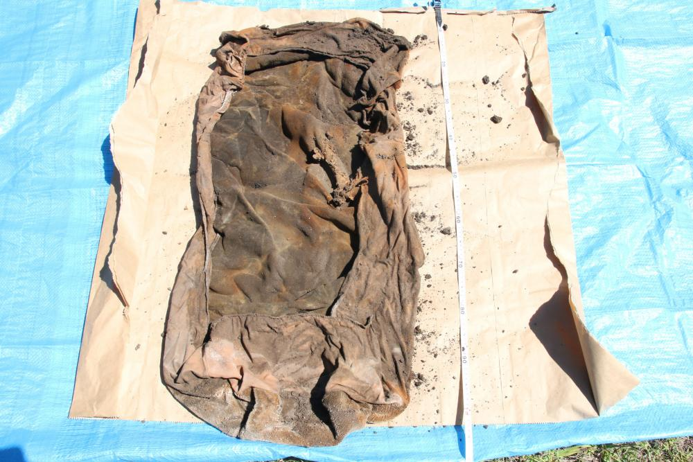 Queensland police are hoping to speak to anyone with information regarding two car seat covers found alongside the remains of Wayne Youngkin in a disused septic tank in Brisbane in November.